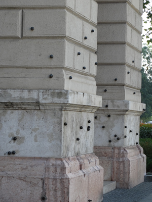 Bullet holes from the 1956 Uprising against communism marked with iron balls.