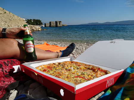 Massive pizza and 2 bottles of good beer, delivered to our beach spot in Medici. Heaven.