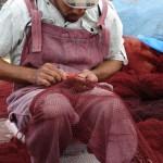 Essaouira fisherman mending his nets