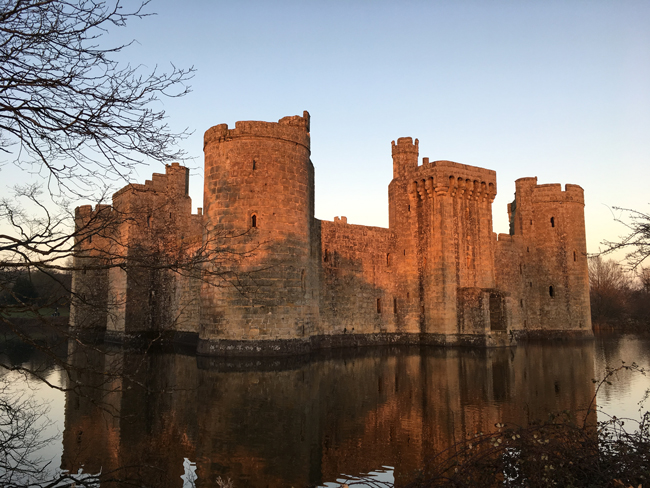 Bodium Castle bathed in the glow of sunset.