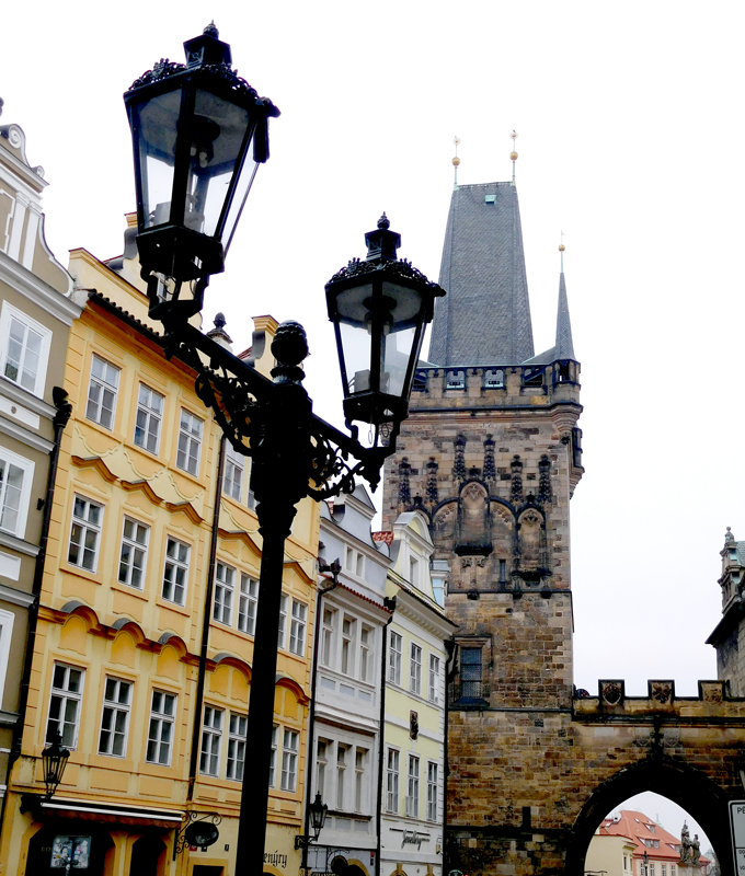 Old world lamp posts and the Old Town Bridge Tower on Charles Bridge.