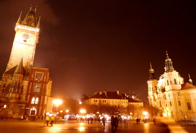 Old Town Square glowing in the warm street lights.