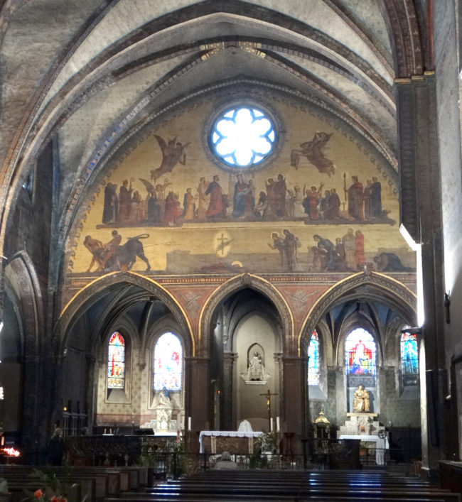 The painted tableau above the alter depicts St Sernin's martyrdom after being dragged behind the bull (taur).